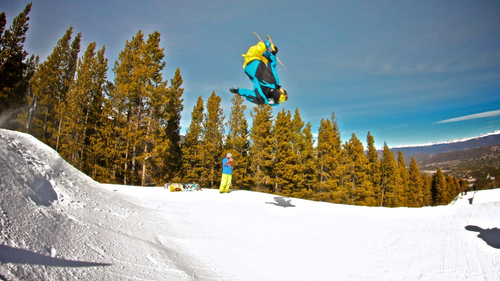 Brandon Enouf throws a flat 360 at Breckenridge, CO on opening day. Photo by Dave Bloom.